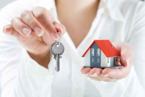 real estate agent handing over keys to home